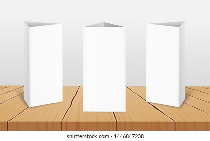 Set of three blank vertical table tent cards to presentate your design from all sides 3d realistic vector mockup on the wooden surface. Restaurant folded paper label.