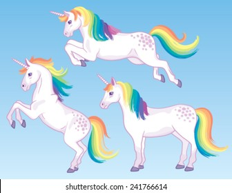 A set of three cartoon unicorns with rainbow manes and tails.