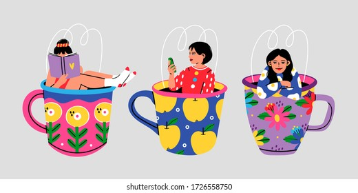Set of three Cute girls sitting in the giant Cups with floral pattern. Funny characters. Hand drawn colored trendy Vector illustration. All elements are Isolated on grey background