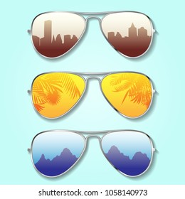 Set of three different sunglasses with city, palms and mountains reflection