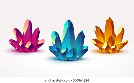 Set of three different vector colorful crystals. Pink, blue and yellow gems isolated on a white background.