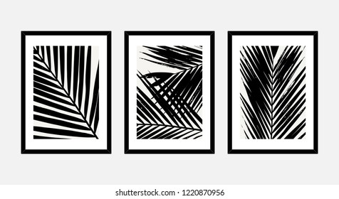 A set of three framed art prints with palm leaves in black and white isolated on light gray background. Abstract art posters, printable greeting cards, t-shirt designs.