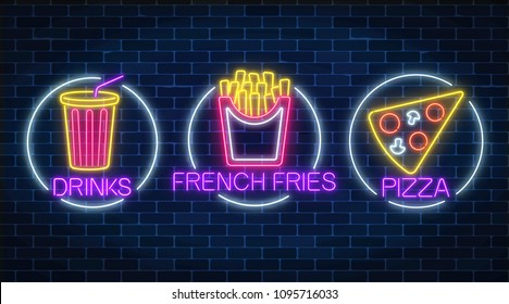 Set of three neon glowing signs of french fries, piece of pizza and soda drink in circle frames on a dark brick wall background. Fastfood light billboard symbol. Cafe menu item. Vector illustration.