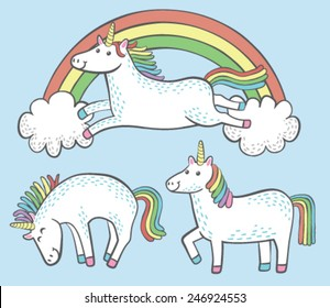 A set of three quirky cartoon unicorns with rainbow manes and tails.