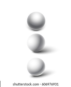 Set of three realistic white spheres with shadows.
