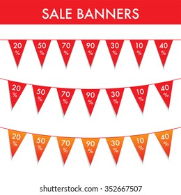 Set of three red sale banners as a string with flags.