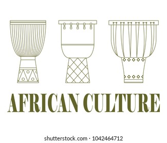 Set of three traditional African drums on a white background.