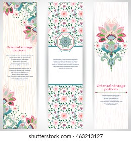 Set of three vertical banners with imitation of wooden texture and strokes on backdrop. Bright traditional oriental flowers. Place for your text.