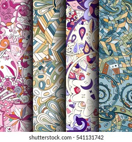 Set of tracery colorful seamless patterns. Curved doodling backgrounds for textile or printing with mehndi and ethnic motives. Vector.