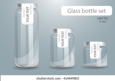 A set of transparent glass bottles. Realistic banks. Isolated on a gray background. Set of different size cans with decals. Labeled cans for dairy products