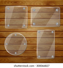 Set of transparent glass plates of different shapes, bolted to wooden planks