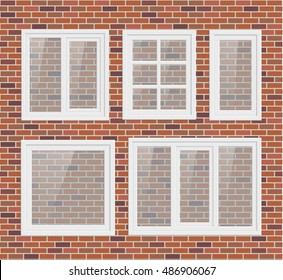 Set of transparent metal plastic windows on brick wall
