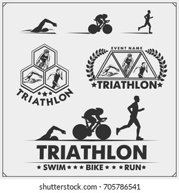 Set of triathlon labels, emblems badges and design elements. Swimming, cycling and running.