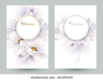 Set of two invitation or congratulation cards with elegant flower composition. Blooming white magnolias formed composition on the white backgrounds.