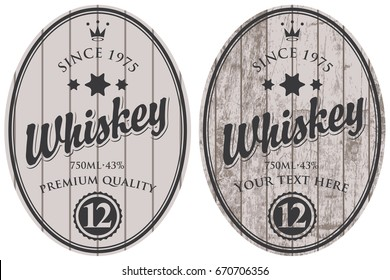 Set of two oval labels for whiskey on a gray wooden background with calligraphic inscription, crown and stars.