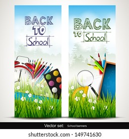 Set of two school banners with school supplies in the grass
