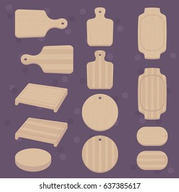 Set of various shapes of cutting boards: round, oval, square with handle. Kitchen cooking essentials.
