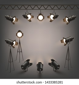 Set of various studio spotlights hanging on the ramp and standing on the tripods 3d realistic vector illustration on dark background. Illumination light from stage projector.
