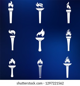 Set of various torches on blue background