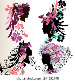 Set of vector abstract faces of girls with floral hair style