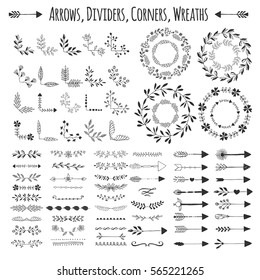 Set of vector arrows, wreaths, corners and dividers. Hand drawn design elements.