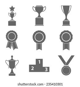Set of vector award success and victory icons with trophies stars cups ribbons rosettes medals medallions wreath and a podium