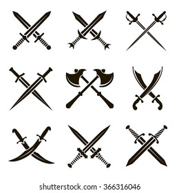 Set of vector black heraldic swords, sabers, rapiers, axes on a white background