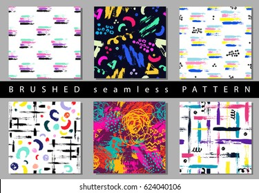 Set of Vector colorful seamless pattern with brush strokes and dots. Pink blue yellow green color on black background. Hand painted grange texture. Ink geometric elements. Fashion modern style Unusual
