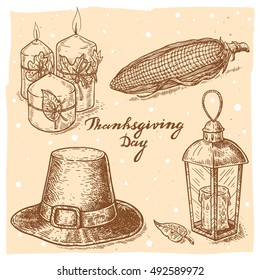 Set of vector hand drawn illustrations of the candles with leaves, corn, pilgrim hat, lantern with candle and handwritten text Thanksgiving Day.Thanksgiving Day set in vintage style.