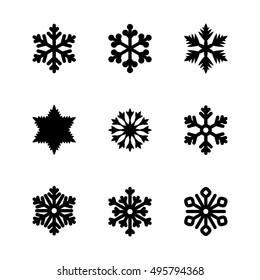 Set of vector icons. Black snowflakes. For illustration for the winter and New Year's theme, well for web sites. Suitable for creating greeting cards.