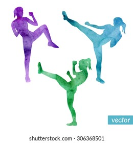 Set of vector illustrations of kickboxing women. Bright silhouettes of slim girls doing kicks.