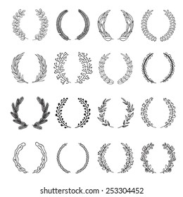 Set of vector laurel wreaths. Vintage designs. Leaves and branches round frames. Hand drawn sketch style.