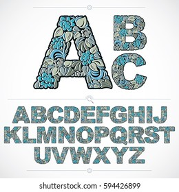 Set of vector ornate capitals, flower-patterned typescript. Blue characters created using herbal texture.