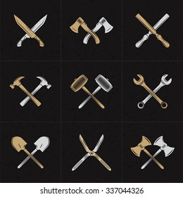 Set of Vector Retro Design Elements for Logotypes. Crossed Tools. Axes, Knifes, Hammer, Wrench, Spoon, Fork. Vector Illustration with White and Brown Elements on Dark Textured Background