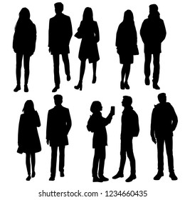 Set of vector silhouettes of men and women in outerwear standing and walking, group of business people. Black color isolated on white background