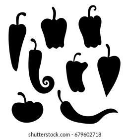 Set of vector silhouettes of peppers. Collection of black silhouettes of vegetables. Stylized plants.