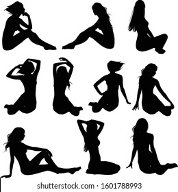 Set of vector silhouettes of slim beautiful girls in bikinis. Black icons of sexy girls sitting in different poses.