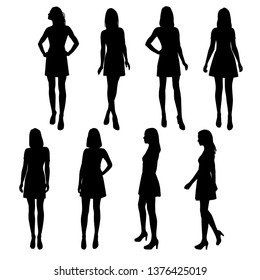Set of vector silhouettes  woman with long legs wearing summer dresses, standing, black color,  isolated on white background