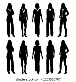 Set of vector silhouettes of women standing in different poses, group of business people in office clothes, black color isolated on white background