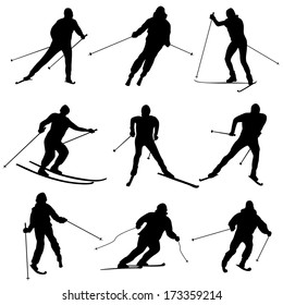 Set of vector simple silhouettes skiers.