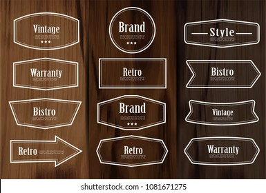 Set of vector vintage style frame labels and elements for design, carve banner on wooden background.