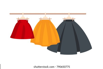 Set Vector Women's High Waisted Street Skirt Skater Pleated Full Midi Skirts on the hanger.three colored skirts on hangers.Clothing for women and girls.illustration isolated from white background
