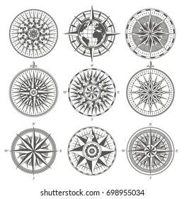 Set of vintage antique wind rose nautical compass signs labels emblems elements. Vector illustration.