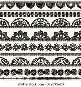 Set of vintage borders. Could be used as divider, frame, etc. Napkins crocheted. Freehand drawing. Black and white.