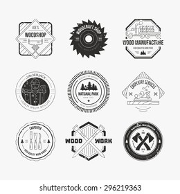 Set of vintage carpentry logotypes made in vector. Wood work and manufacture label templates. Detailed emblems with timber industry elements and carpentry tools.