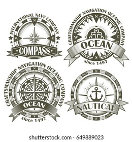 Set of vintage compasses with a wind rose and anchors