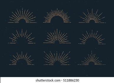 Set of vintage hand drawn sunbursts on dark background. Starburst, sunrays. Design elements.
