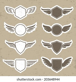 Set of vintage heraldic shapes with wings in vector