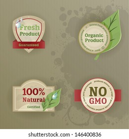 Set of vintage labels with ecological thematics - fresh, natural, organic, and GMO-free guarantee labels. EPS10