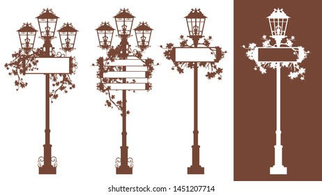 set of vintage looking iron streetlights with blank information banners among autumn maple foliage - fall season urban silhouette vector design set